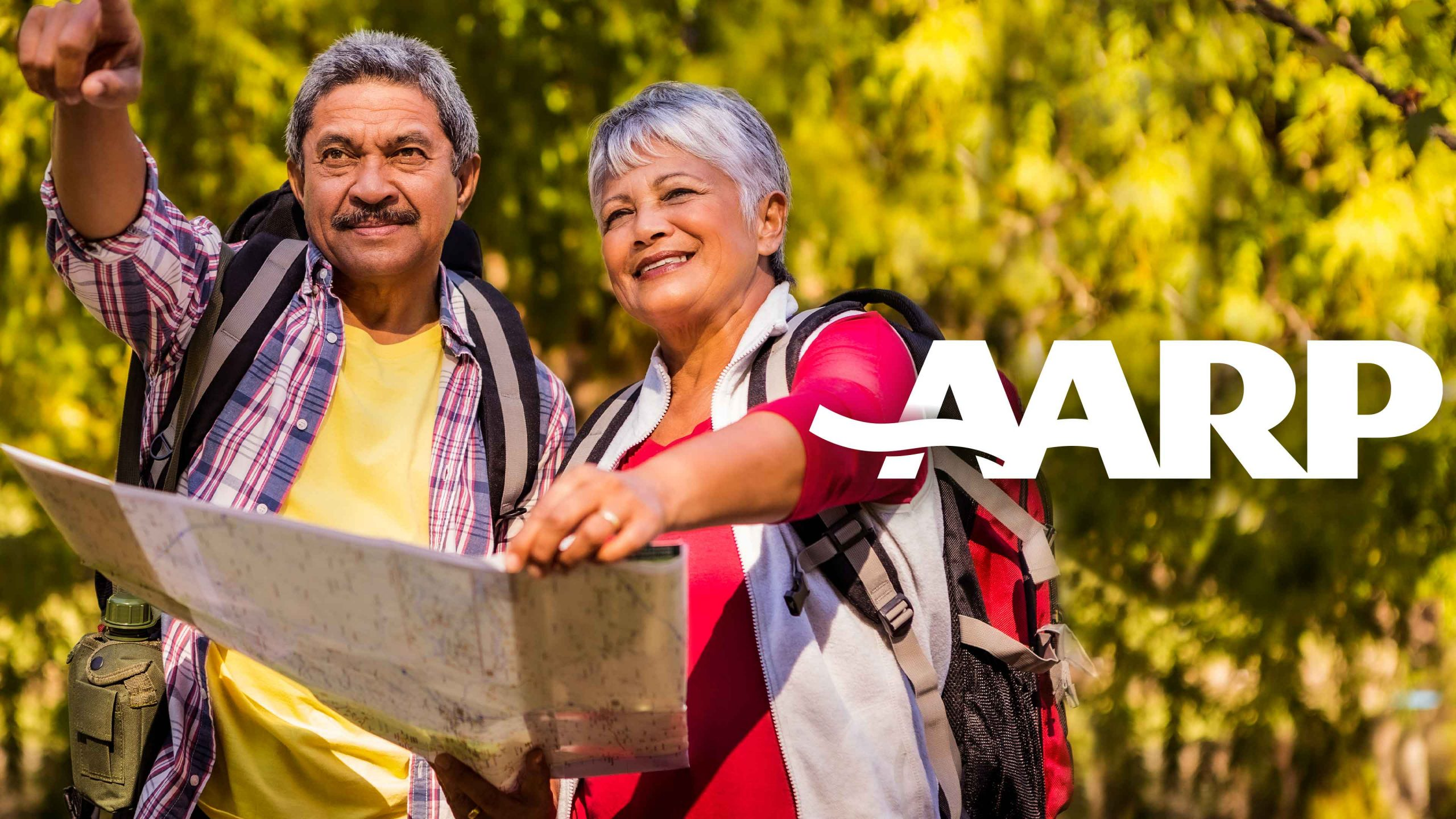 Mature couple on an adventure outdoors with AARP logo
