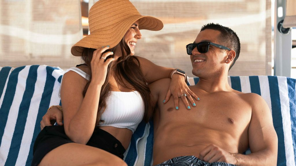 Couple relaxing in a daybed at The Pool at Grand Sierra Resort